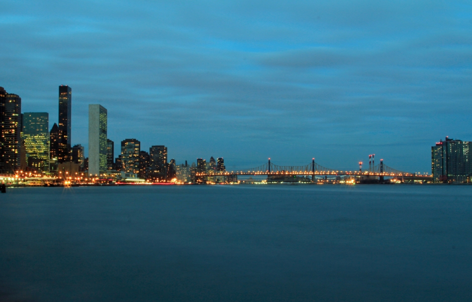 UN and 59th St Bridge from the East River walk at twilight